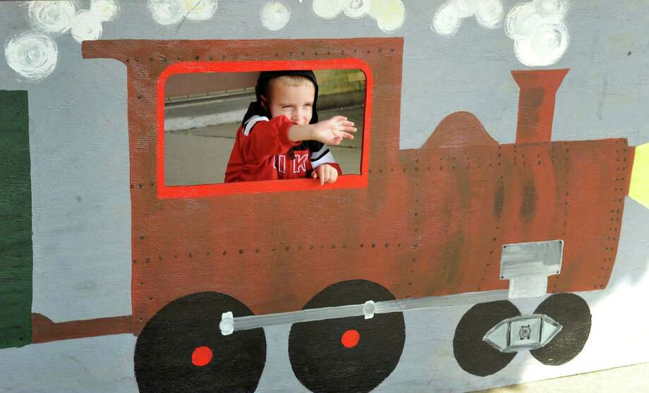 Sean Conlin, 3, waves to his mom, during the Danbury Railway Museum Pumpkin Patch train rides in Danbury, Conn. Sunday, Oct. 13, 2013. Photo: Michael Duffy / The News-Times