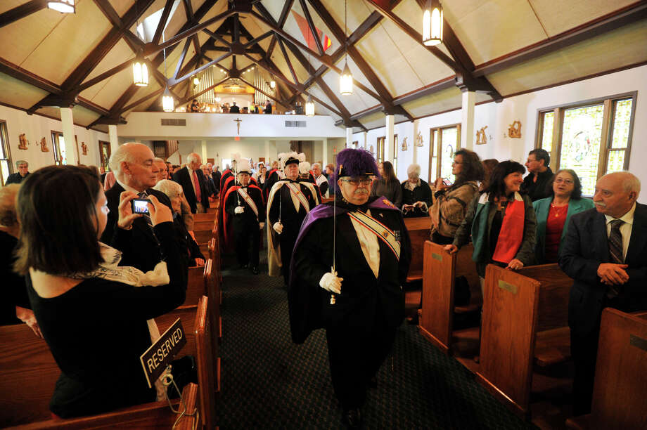Giuseppe Pampena leads the Knights of Columbus down the aisle of Sacred Heart Church during Columbus Day festivities in Stamford, Conn., on Sunday, Oct. 13, 2013. Photo: Jason Rearick / Stamford Advocate