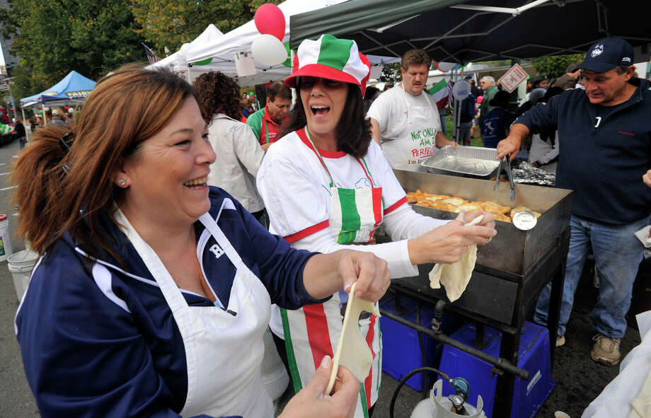 Leanor Battinelli, left, and Stacey Sass chat while shaping dough for pizza frittas during Columbus Day festivities at Columbus Park in Stamford, Conn., on Sunday, Oct. 13, 2013. Photo: Jason Rearick / Stamford Advocate