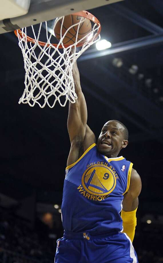 "Andre Iguodala, dunking during a Warriors preseason game, says of the trip to China that his teammates must ""man up and remember to get your work done."" Photo: Alex Gallardo, Associated Press"