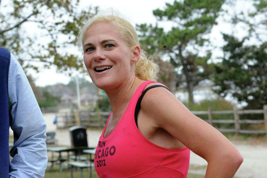Liz Herbert, of Darien, the first woman runner at 16th annual SusannahâÄôs Run at Greenwich Point Park, in Old Greenwich, Conn., Sunday, Oct. 14, 2013. Photo: Helen Neafsey / Greenwich Time