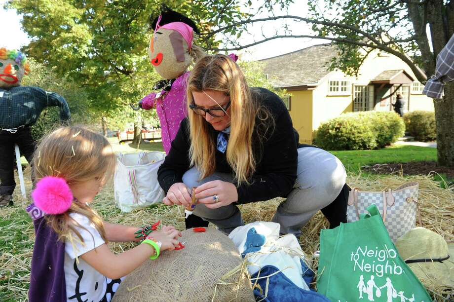 India, 4, Lathrop and her mother, Ashley, make a scarecrow at Fall Festival and Scarecrow Competition on Bush-Holley Historic Site, in Cos Cob, Conn., Sunday, Oct.13, 2013. Photo: Helen Neafsey / Greenwich Time