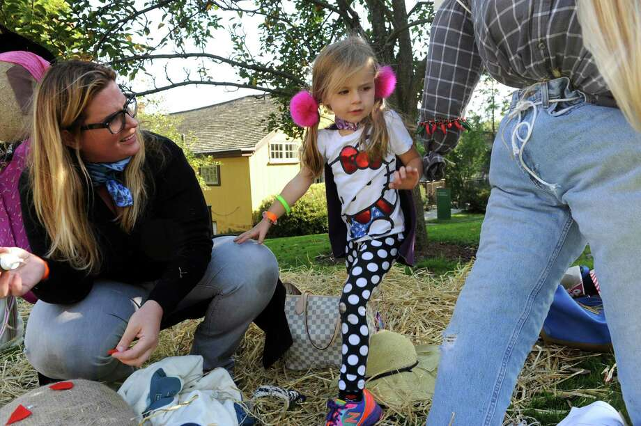 Ashley Lathrop and her daughter, India, 4, make a scarecrow at Fall Festival and Scarecrow Competition on Bush-Holley Historic Site, in Cos Cob, Conn., Sunday, Oct.13, 2013. Photo: Helen Neafsey / Greenwich Time