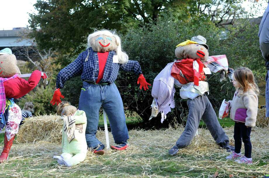 Hannah Fuzesi, 3, looks at the scarecrows at Fall Festival and Scarecrow Competition on Bush-Holley Historic Site, in Cos Cob, Conn., Sunday, Oct.13, 2013. Photo: Helen Neafsey / Greenwich Time