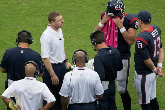 Houston Texans quarterback Matt Schaub (8) talks with head coach Gary Kubiak and quarterback T.J. Yates (13) during a timeout in first half of an NFL football game at Reliant Stadium on Sunday, Oct. 13, 2013, in Houston.