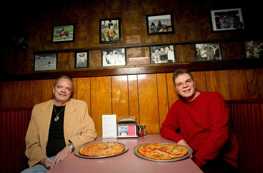 Gary James, left and his brother Jim Screws, right, the owners of Colony Grill in Stamford, Conn. on Thursday, Jan. 21, 2010. Photo: Chris Preovolos / Stamford Advocate