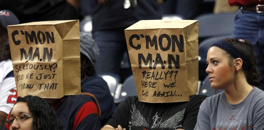 Fans wear bags during the fourth quarter. Photo: Brett Coomer, Houston Chronicle