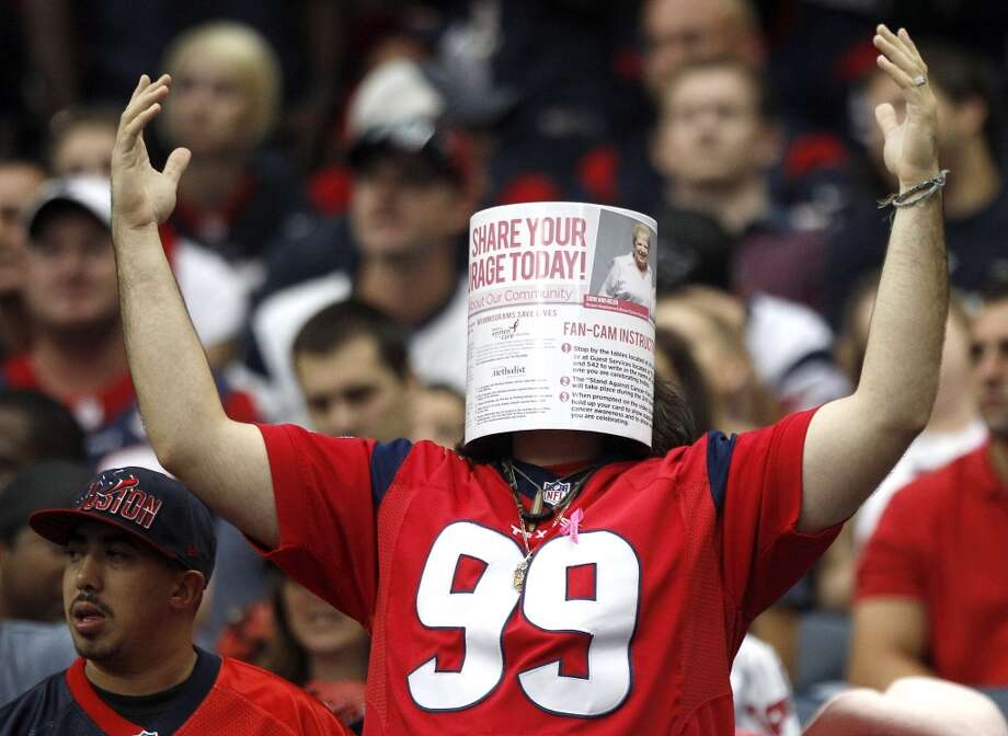 A fan covers his face during the fourth quarter. Photo: Brett Coomer, Houston Chronicle