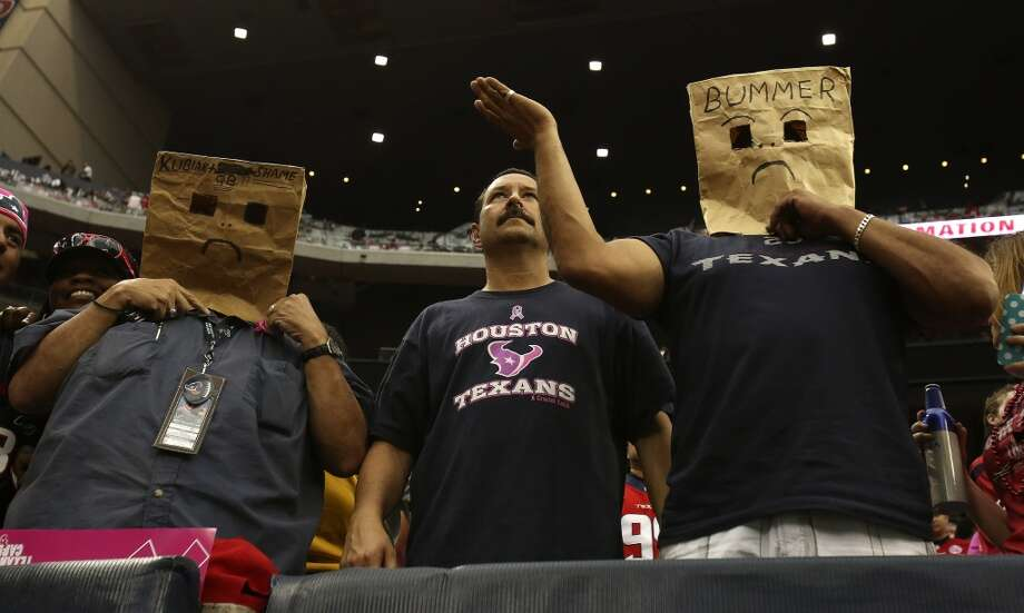 Fans wear bags during the fourth quarter . Photo: Karen Warren, Houston Chronicle