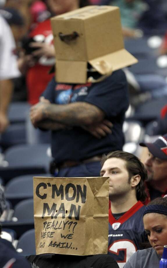 Fans wear bags and boxes as they react to the loss. Photo: Brett Coomer, Houston Chronicle