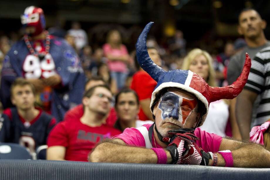 Fan Chris Lockeridge reacts to the loss. Photo: Brett Coomer, Houston Chronicle