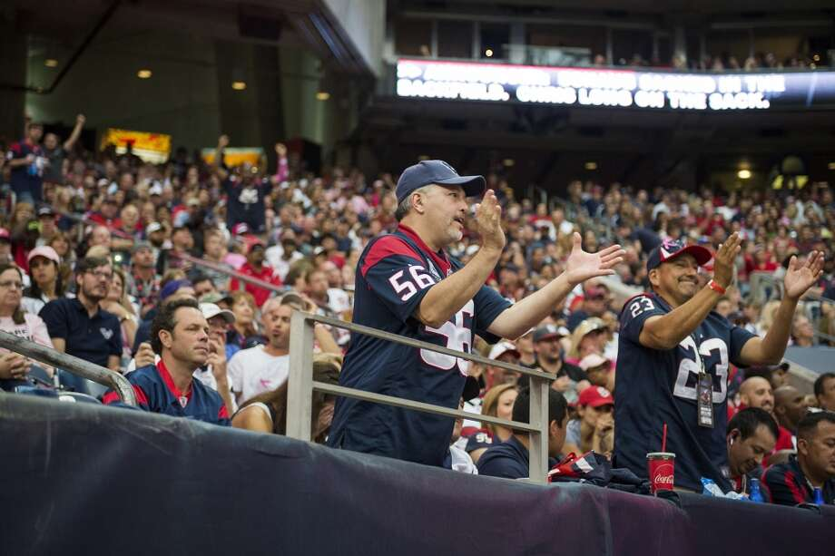Fans cheer after an injury to quarterback Matt Schaub during the second half. Photo: Smiley N. Pool, Houston Chronicle