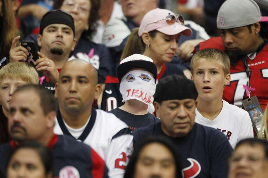 Fans look on as the Texans play the Rams in the first quarter. Photo: Brett Coomer, Houston Chronicle