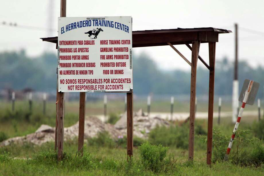 Nine people, including six law enforcement officers, were charged with operating an illegal horse racing track in 2013, in Crosby. Photo: Mayra Beltran, Houston Chronicle / © 2013 Houston Chronicle