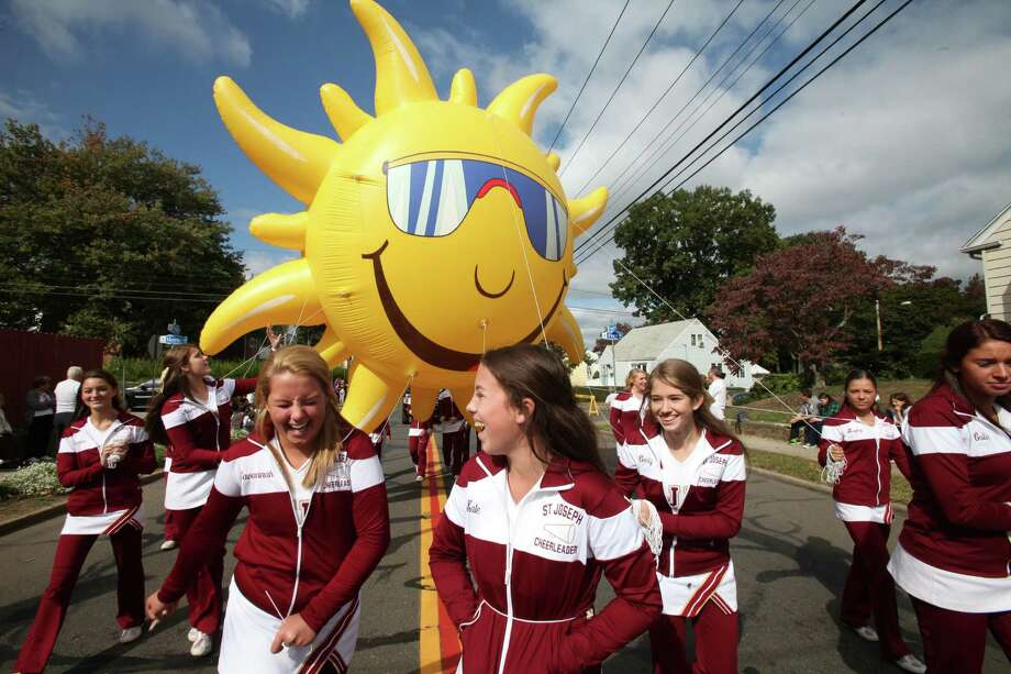 St Joseph cheerleaders march in the 105th Columbus Day Parade in Bridgeport, Conn. on Sunday, Oct. 13, 2013. Photo: BK Angeletti, B.K. Angeletti / Connecticut Post freelance B.K. Angeletti