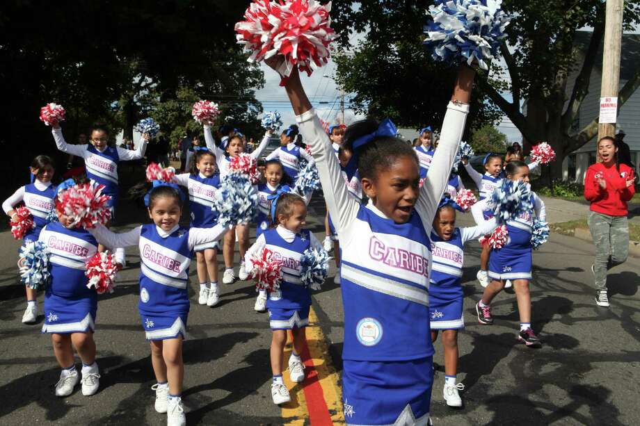 Caribe cheerleaders march in the 105th Columbus Day Parade in Bridgeport, Conn. on Sunday, Oct. 13, 2013. Photo: BK Angeletti, B.K. Angeletti / Connecticut Post freelance B.K. Angeletti