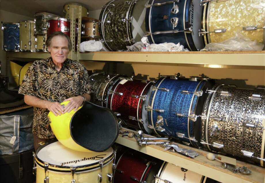 James Glay poses with his collection of vintage drums in Arlington Heights, Ill. Every passing month an unanswered resume dimmed Glay's optimism more. His career in sales was ended by a layoff. So with no job in sight, he created his own. Photo: M. Spencer Green / Associated Press