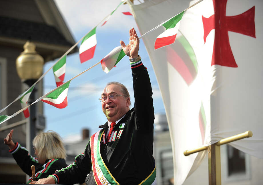 Grand Marshal Michael J. Marella, Jr. waves to the crowd during the annual Columbus Day Parade on Madison Avenue in Bridgeport, Conn. on Sunday, October 13, 2013. Photo: Brian A. Pounds / Connecticut Post