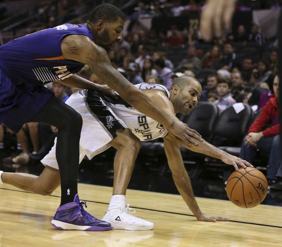 San Antonio Spurs' Tony Parker scrambles for a loose ball with Phoenix Suns' Markieff Morris during the first half at the AT&T Center, Sunday, Oct. 13, 2013. Photo: San Antonio Express-News