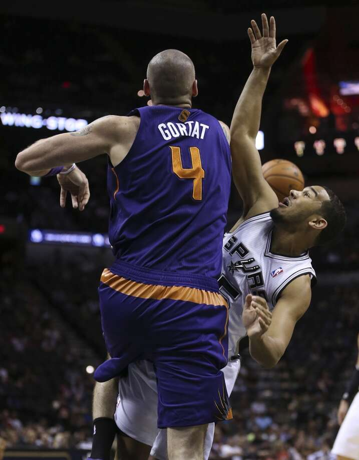 San Antonio Spurs' Cory Joseph is blocked by Phoenix Suns' Marcin Gortat during the first half at the AT&T Center, Sunday, Oct. 13, 2013. Photo: San Antonio Express-News