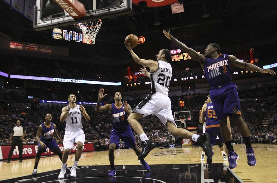 San Antonio Spurs' Manu Ginobili drives for two during the first half against the Phoenix Suns at the AT&T Center, Sunday, Oct. 13, 2013. Photo: San Antonio Express-News
