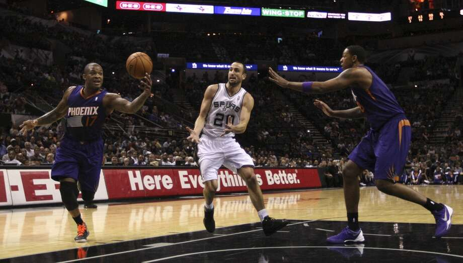 Phoenix Suns' P.J. Tucker, (17), steals a pass for San Antonio Spurs' Manu Ginobili as Channing Frye, right, helps out during the first half at the AT&T Center, Sunday, Oct. 13, 2013. Photo: San Antonio Express-News