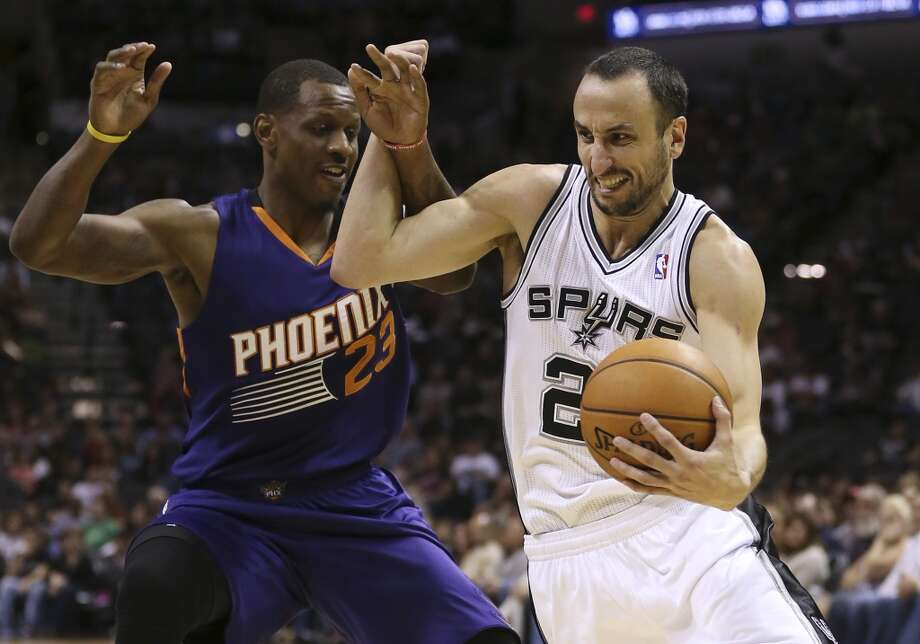 San Antonio Spurs' Manu Ginobili gets around Phoenix Suns' James Nunnally during the first half at the AT&T Center, Sunday, Oct. 13, 2013. Photo: San Antonio Express-News