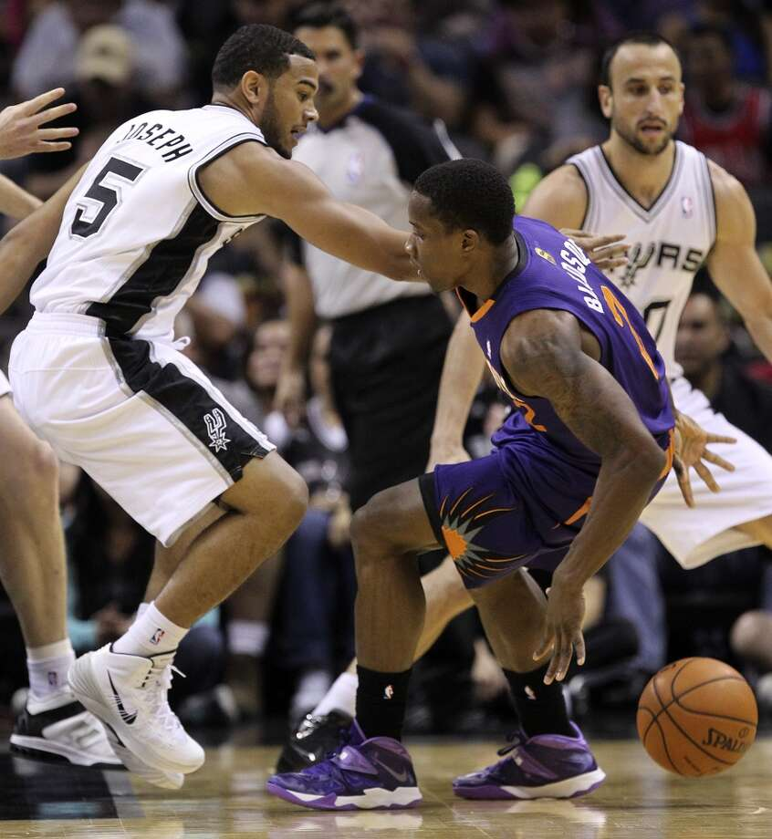 San Antonio Spurs' Cory Joseph puts pressure on Phoenix Suns' Eric Bledsoe during the first half at the AT&T Center, Sunday, Oct. 13, 2013. Photo: San Antonio Express-News