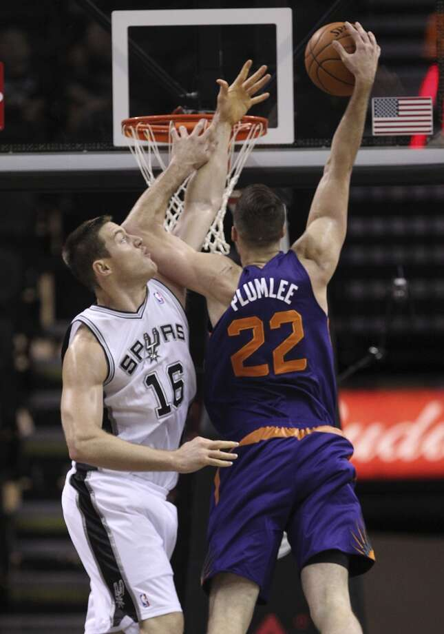 Phoenix Suns' Miles Plumlee dunks over San Antonio Spurs' Aron Baynes during the first half at the AT&T Center, Sunday, Oct. 13, 2013. Photo: San Antonio Express-News