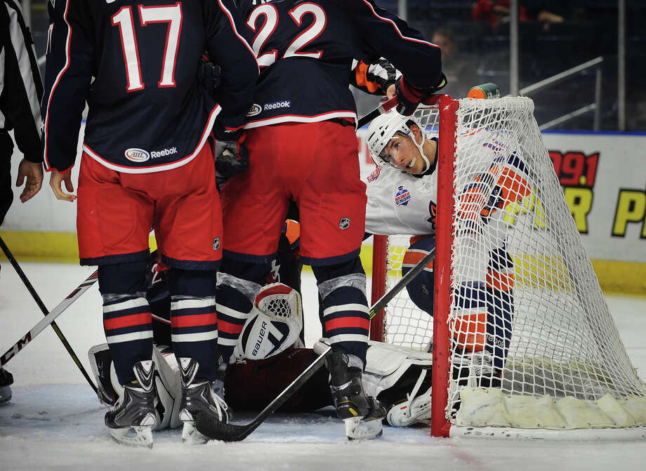 Sound Tiger Ryan Strome looks to extricate himself after being knocked inside the Springfield net during the second period of their AHL hockey matchup at the Webster Bank Arena in Bridgeport, Conn. on Sunday, October 13, 2013. Photo: Brian A. Pounds / Connecticut Post