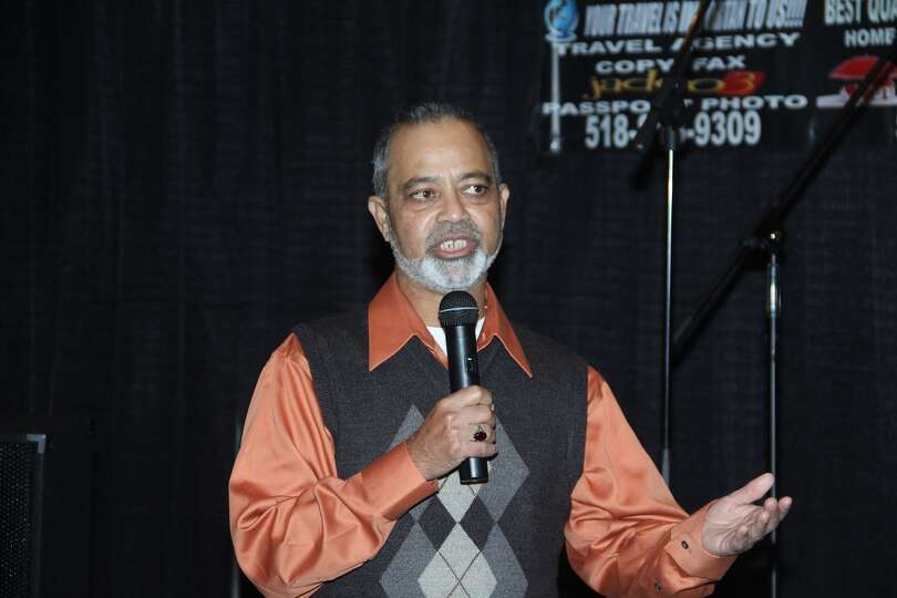 Afaq Khan, editor of Roshni, a local weekly bilingual magazine, speaks at the second anniversary cel