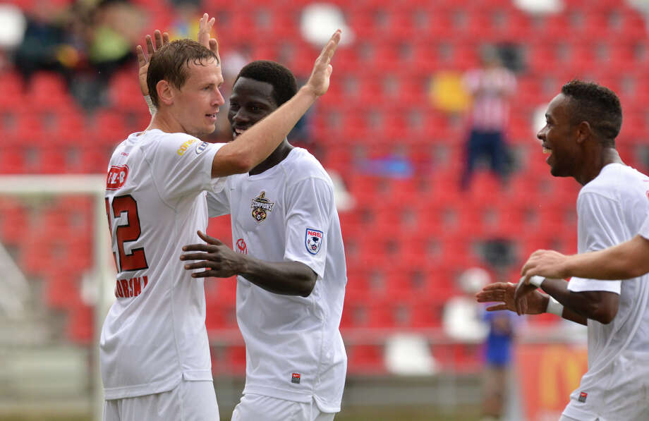 Scopions Tomasz Zahorski (left) is congratulated by teammates Sainey (cq) Touray and Dennis Chin after scoring the game's only goal in the Scorpions 1-0 victory over Edmonton Sunday afternoon at Toyota Field. Photo: Robin Jerstad