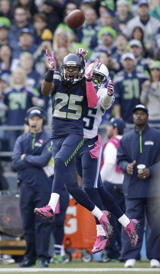 Seattle Seahawks cornerback Richard Sherman (25) intercepts a pass intended for wide receiver Nate Washington, right, during the second half of an NFL football game, Sunday, Oct. 13, 2013, in Seattle. (AP Photo/Scott Eklund) Photo: ASSOCIATED PRESS