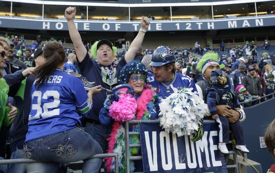 Seattle Seahawks fans celebrate after the Seahawks defeated the Tennessee Titans 20-13 in an NFL football game, Sunday, Oct. 13, 2013, in Seattle. (AP Photo/Scott Eklund) Photo: AP