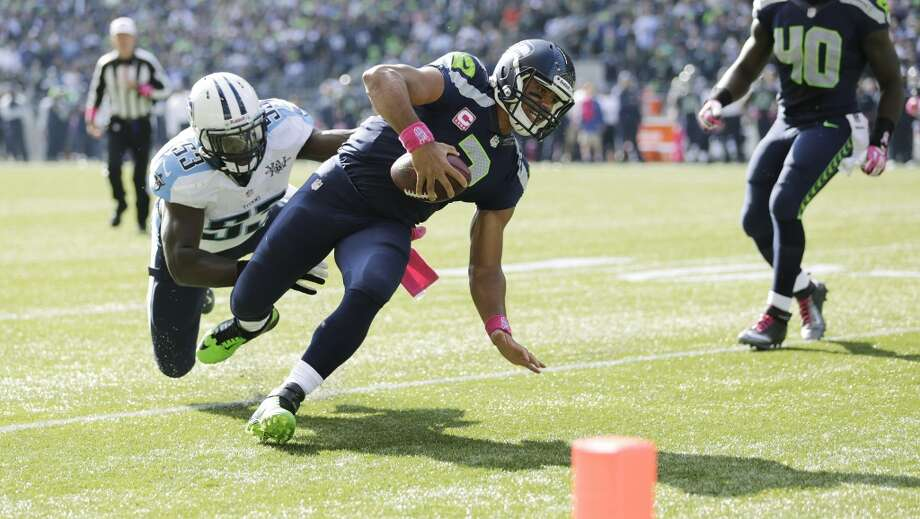Seattle Seahawks quarterback Russell Wilson (3) is tackled by Tennessee Titans middle linebacker Moise Fokou (53) near the goal line during the first half of an NFL football game, Sunday, Oct. 13, 2013, in Seattle. (AP Photo/Scott Eklund) Photo: ASSOCIATED PRESS