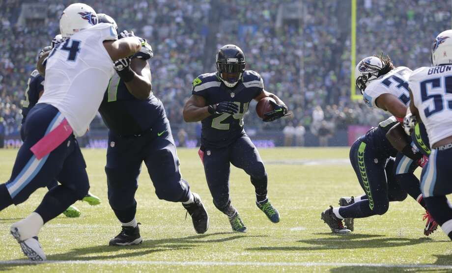 Seattle Seahawks Marshawn Lynch (24) runs for a touchdown against the Tennessee Titans in the first half of an NFL football game, Sunday, Oct. 13, 2013, in Seattle. (AP Photo/Elaine Thompson) Photo: AP