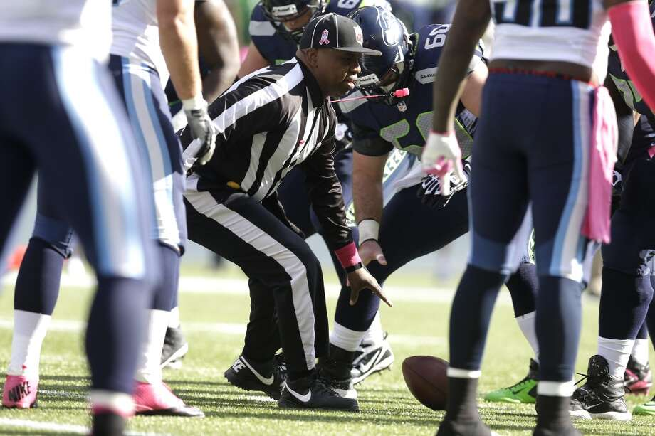 NFL umpire Undrey Wash drops the ball as he rushes to place it on a Seattle Seahawks field goal attempt in the first half of an NFL football game against the Tennessee Titans, Sunday, Oct. 13, 2013, in Seattle. (AP Photo/Elaine Thompson) Photo: AP