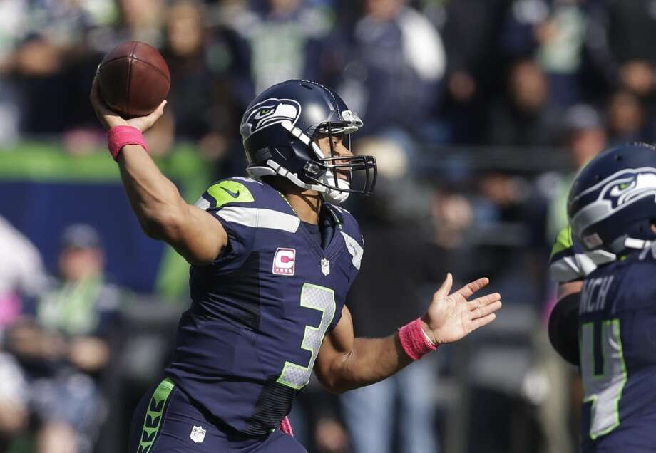 Seattle Seahawks quarterback Russell Wilson passes against the Tennessee Titans in the first half of an NFL football game, Sunday, Oct. 13, 2013, in Seattle. (AP Photo/Elaine Thompson) Photo: AP