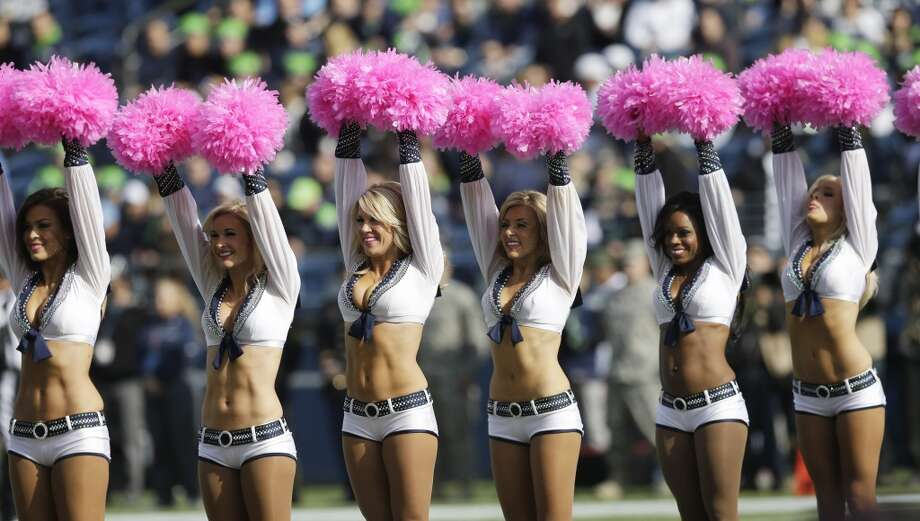 Seattle Seahawks Sea Gals cheerleaders perform wearing pink for breast cancer awareness before an NFL football game between the Seattle Seahawks and the Tennessee Titans, Sunday, Oct. 13, 2013, in Seattle. (AP Photo/Elaine Thompson) Photo: ASSOCIATED PRESS