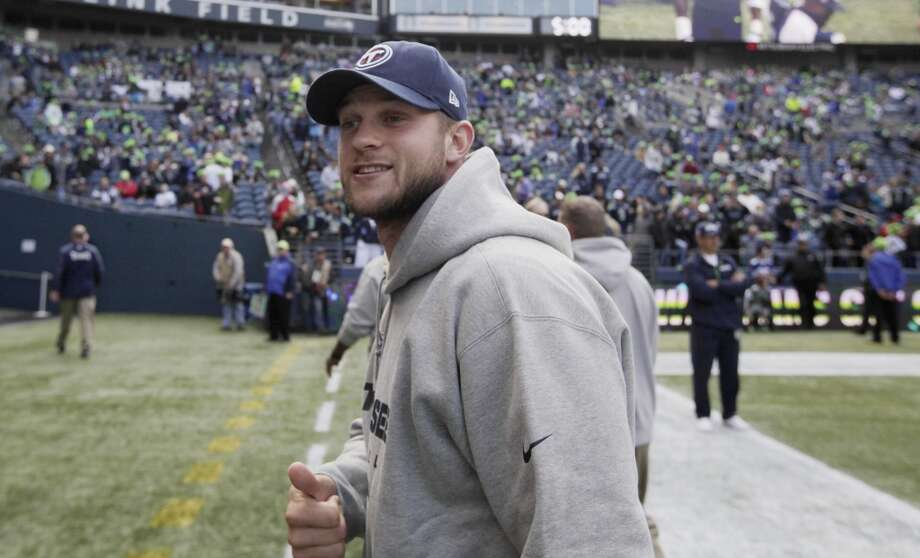 Injured Tennessee Titans quarterback Jake Locker walks on the field prior to an NFL football game against the Seattle Seahawks, Sunday, Oct. 13, 2013, in Seattle. (AP Photo/Scott Eklund) Photo: AP
