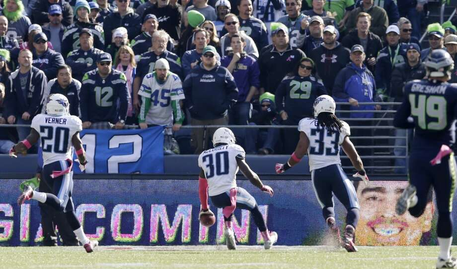 Tennessee Titans' Jason McCourty (30) runs for a touchdown against the Seattle Seahawks during first half of an NFL football game, Sunday, Oct. 13, 2013, in Seattle. (AP Photo/Elaine Thompson) Photo: AP