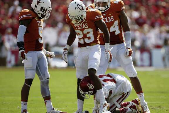 Oklahoma's Lacoltan Bester feels the wrath of a suddenly dominant Texas defense.