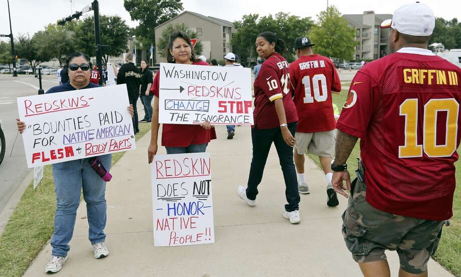 Diana Parton, a member of the Caddo Nation, (from left) and Yolanda Blue Horse, a member of the Lakota Nation, protest with others as Ingrid Johnson looks on before the Dallas Cowboys and Washington Redskins game Sunday Oct. 13, 2013 at AT&T Stadium in Arlington, Tx. Photo: Edward A. Ornelas/Express-News