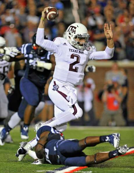 Johnny Manziel victimizes another defender as he scrambled to 113 yards on 18 carries Saturday night. Photo: Austin McAfee, MBR / The Daily Mississippian