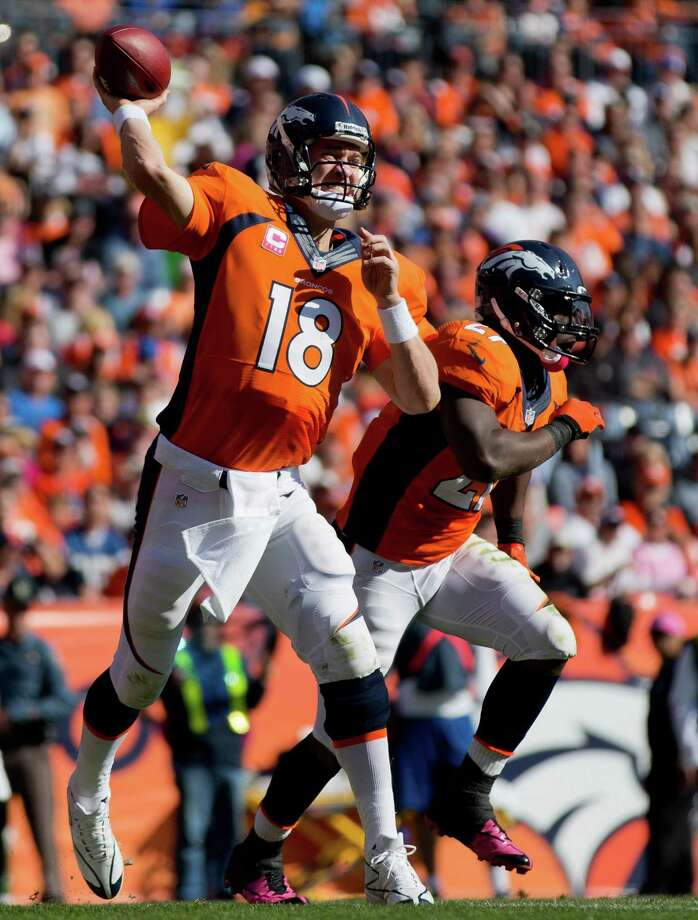 DENVER, CO - OCTOBER 13:  Quarterback Peyton Manning #18 of the Denver Broncos throws a pass against the Jacksonville Jaguars at Sports Authority Field Field at Mile High on October 13, 2013 in Denver, Colorado. (Photo by Justin Edmonds/Getty Images) ORG XMIT: 179691020 Photo: Justin Edmonds / 2013 Getty Images