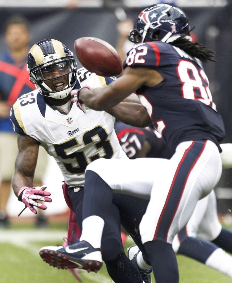 Rams linebacker Daren Bates knocks the ball away from Keshawn Martin on a kickoff return during the third quarter. Bates picked up the fumble and ran the ball in for a touchdown on the play. Photo: Brett Coomer, Houston Chronicle