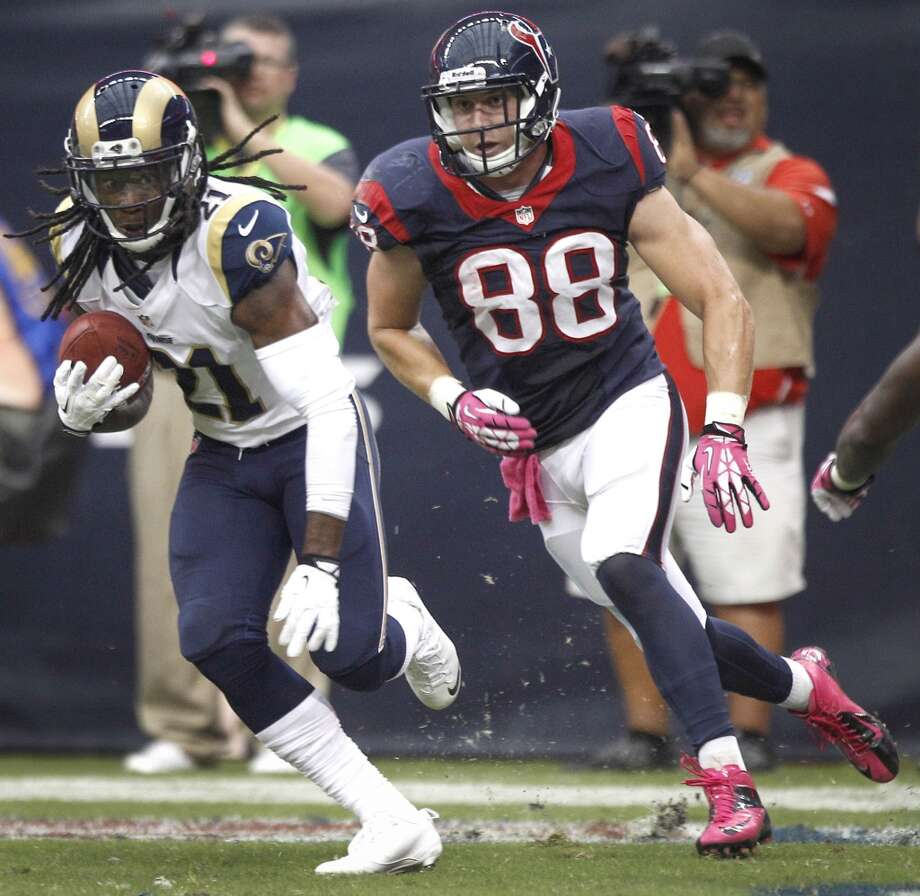 Rams cornerback Janoris Jenkins (21) runs away from Texans tight end Garrett Graham (88) as he returns an interception of a pass by Texans quarterback T.J. Yates during the fourth quarter. Photo: Brett Coomer, Houston Chronicle