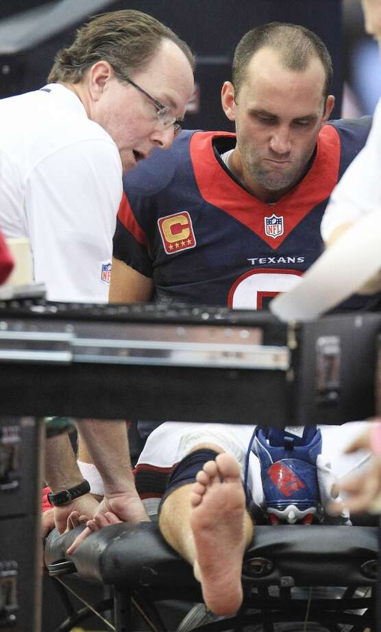 Texans quarterback Matt Schaub sits injured on the sideline during the third quarter. Photo: Karen Warren, Houston Chronicle