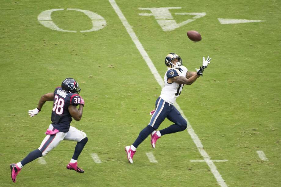 Rams wide receiver Chris Givens has a long pass go off his hands after getting behind Texans strong safety Danieal Manning during the first half. Photo: Smiley N. Pool, Houston Chronicle
