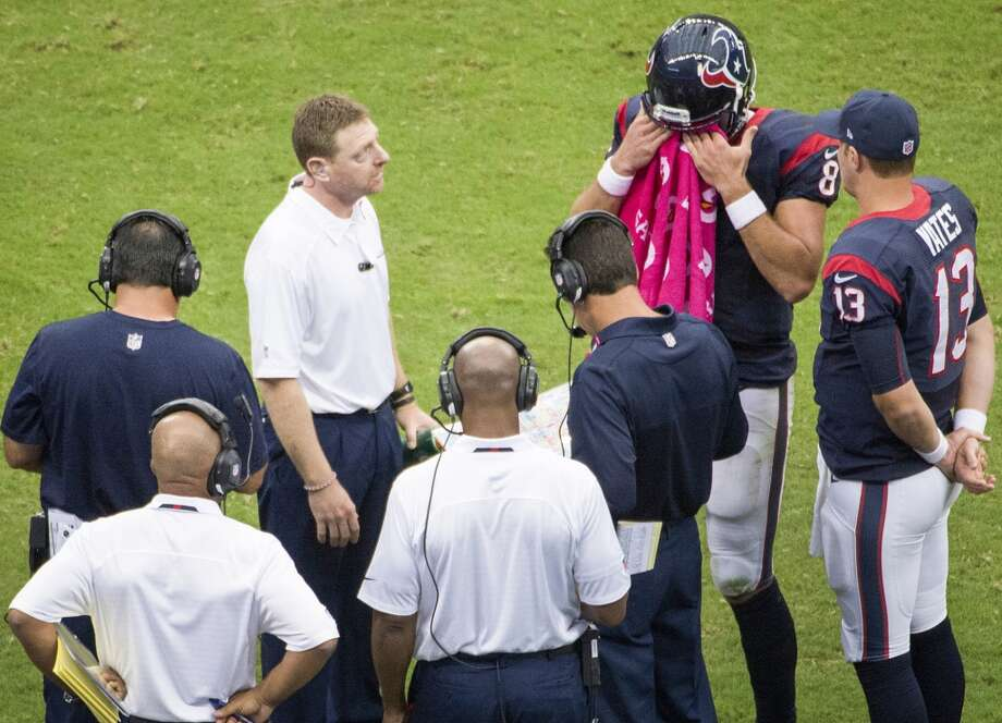 Texans quarterback Matt Schaub talks with head coach Gary Kubiak and quarterback T.J. Yates during a timeout. Photo: Smiley N. Pool, Houston Chronicle